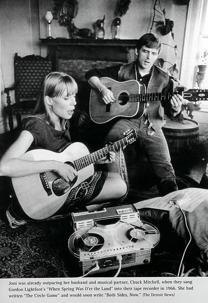 Joni Mitchell and her husband Chuck with an at home little reel to reel running to record their work...Toronto Canada 1967.