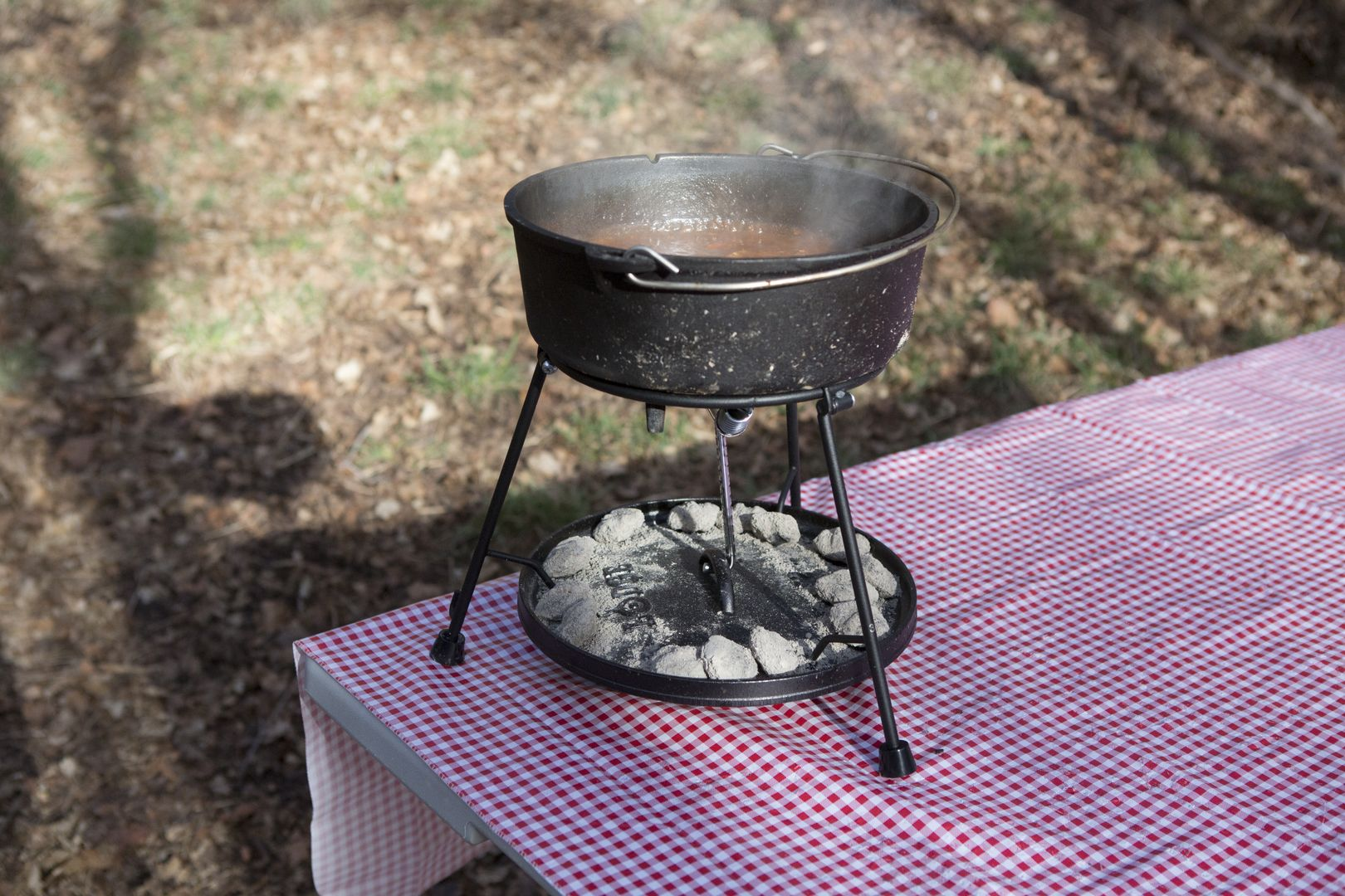 A Dutch Oven Lid Holder That Doubles As A Stand A Grill Accessory And More 39 From This Place Want Oven Accessories Grilling Grill Accessories