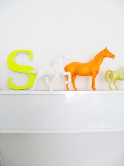 Neon monogram on a shelf {via Remodelista}