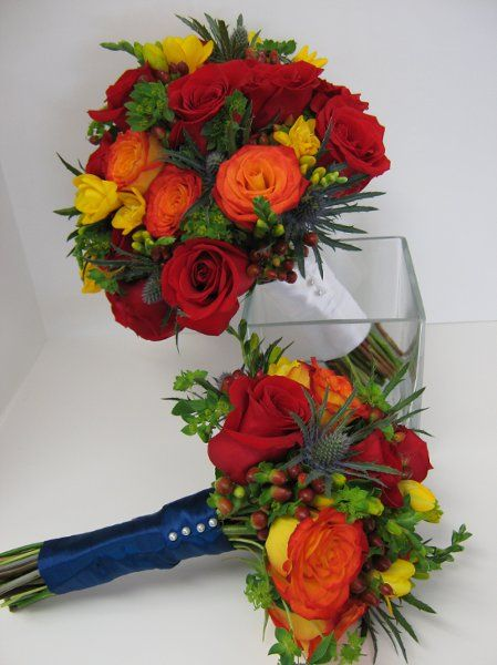 My photo album wedding flowers and weddings bouquets of red and circus roses yellow fressia hypericum berries blue thistle and mightylinksfo