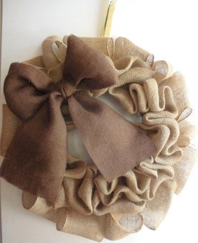 Made of Brown Burlap.    Attached to an 14 inch wire base with craft wire and glue. Burlap is a medium brown. Simplistic.    Burlap is sun