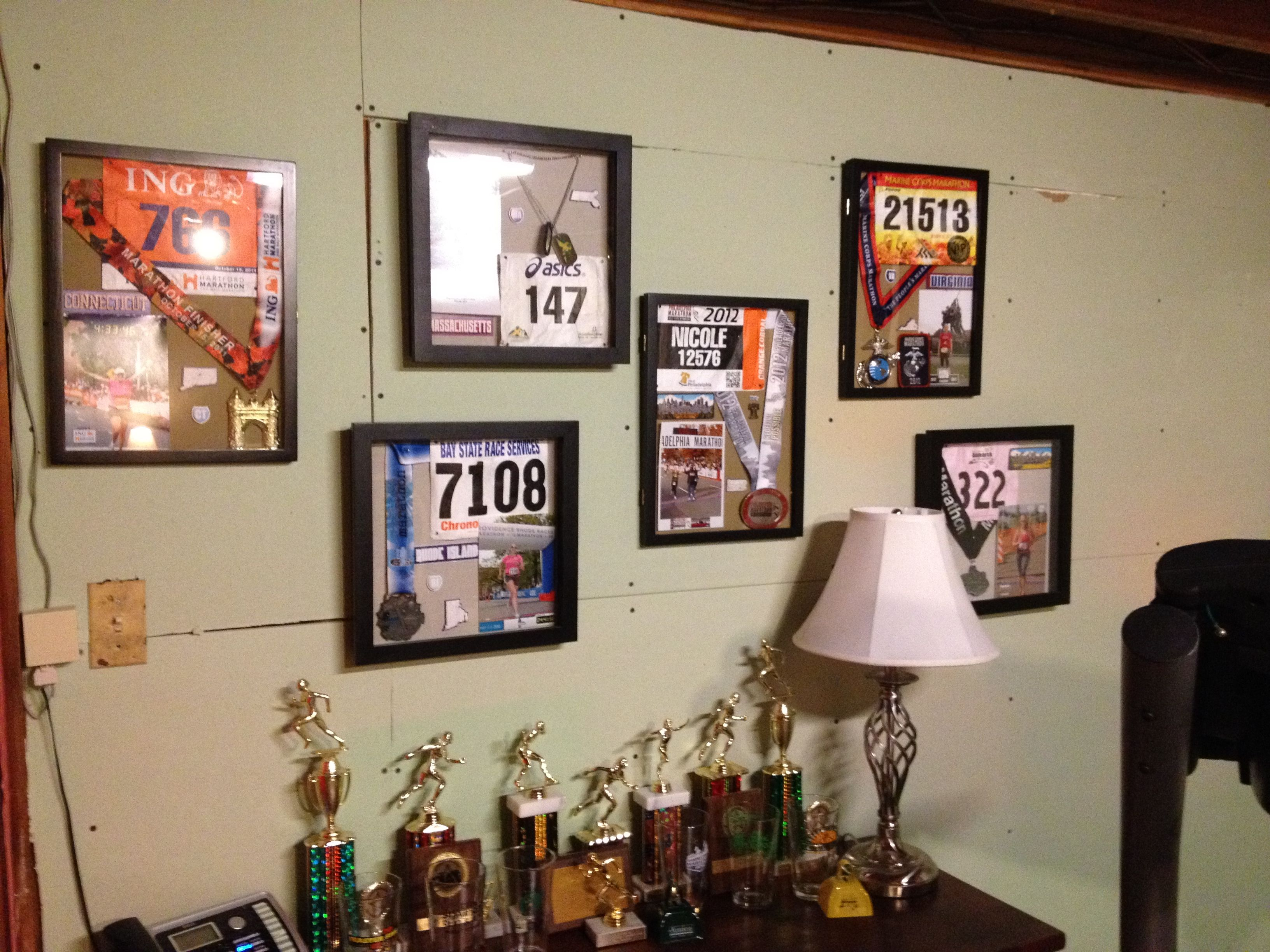 Shadow boxes from my marathons. Including photo, bib, medal, and stickers corresponding to the state. 6 out of 50 states completed!