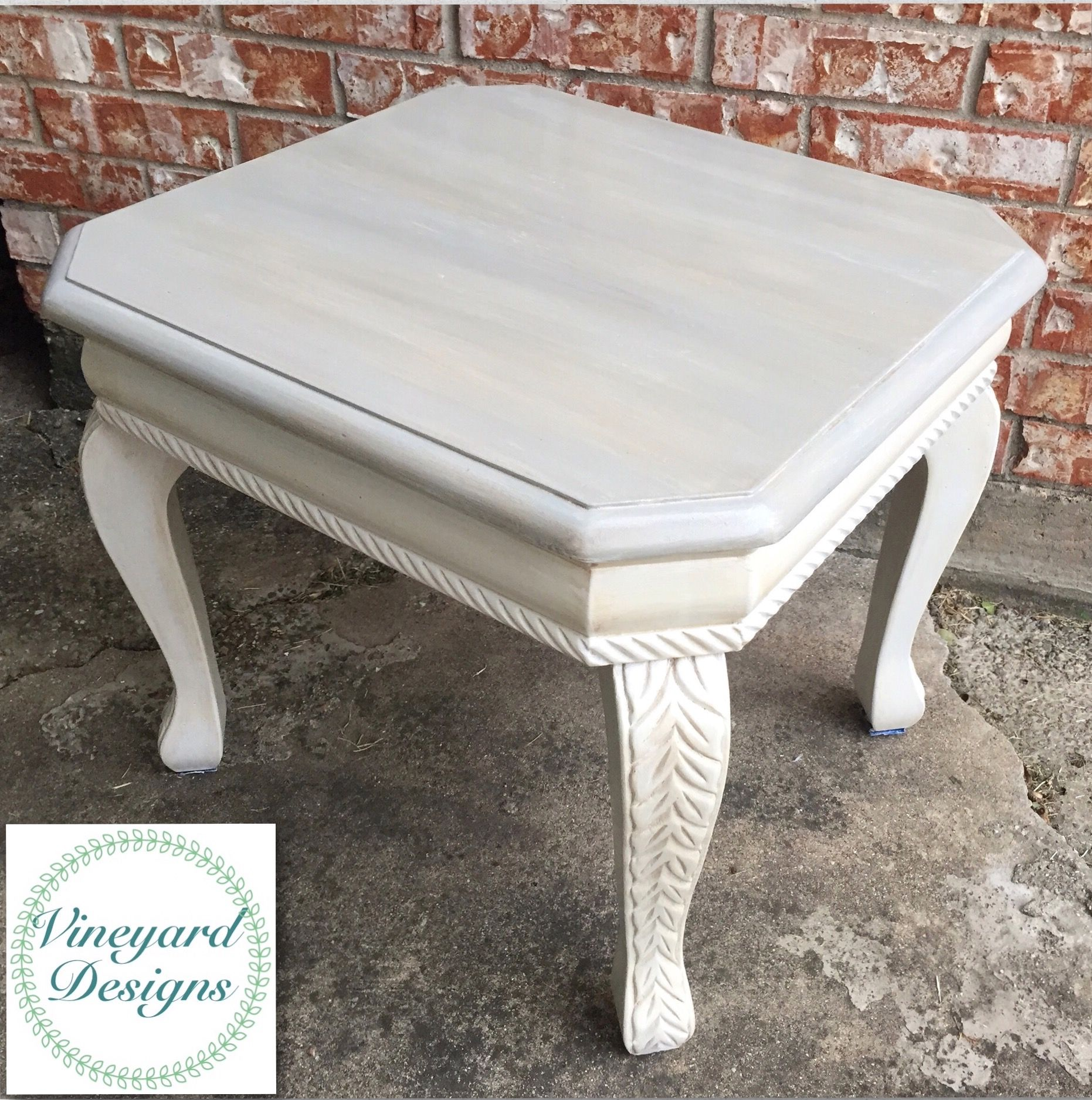 This beautiful end table was painted with gray paint white chalk