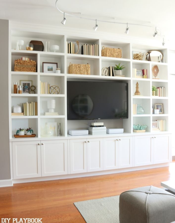 This White Built In Entertainment Center Makes Room Feel Grand And Inviting