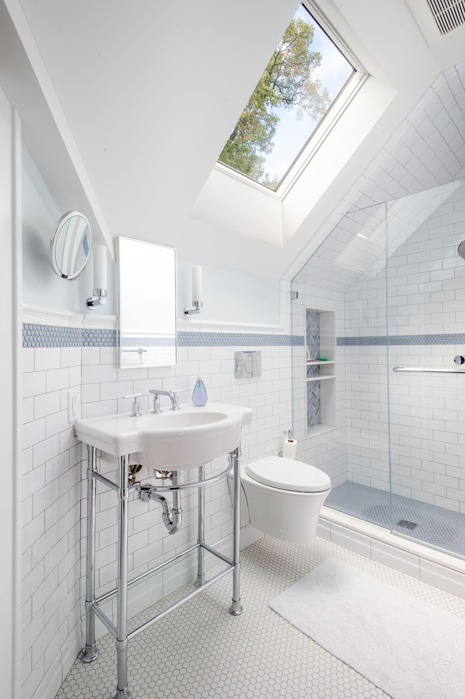 A 1920s Renovated Attic In Pelham Showcases A New Topper In 2020 Bathroom Floor Tiles Bathroom Renovation Bathroom Flooring