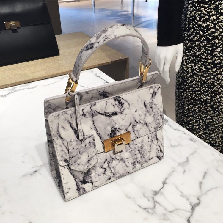 A work of art: the @balenciaga Le Dix Cartable bag in white and grey marble-print smooth leather. Shop the link in our bio.