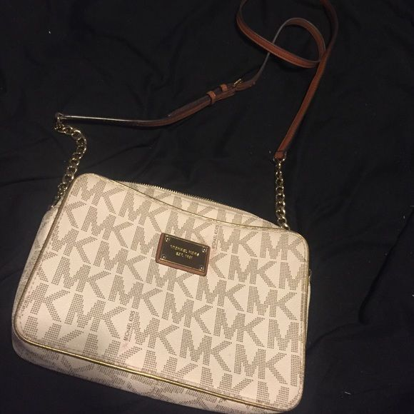84b85496125b ... bag Michael kors cream and brown MK logo cross body bag. Has slight dis  colorization on back of bag from my jeans still in great condition. Super  cute!