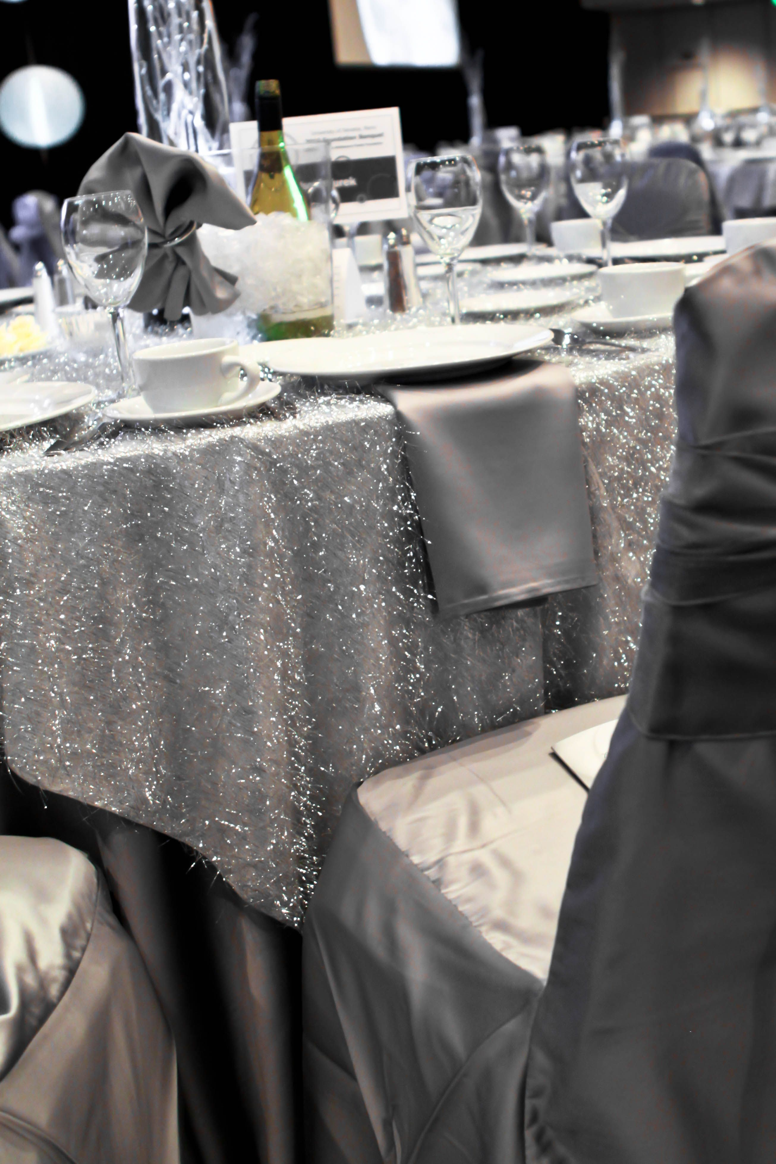 Grey wedding decoration ideas  shimmery silver wedding table cloth  silver wedding table decor
