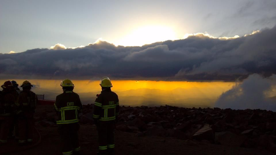 This photo is not from the Waldo Canyon Fire, but was taken a few days before, on the summit of Pikes Peak. A bit of smoke from the Springer fire can be seen in the background.