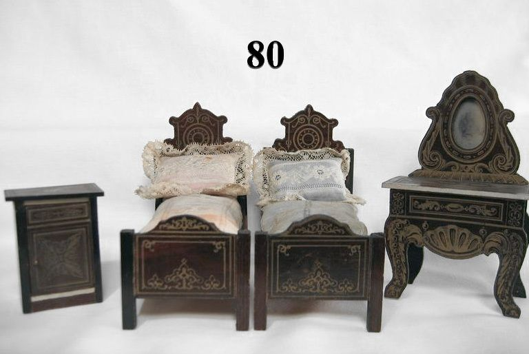 4 PCS including two matching Biedermeier beds with high headboards and particularly nice stenciled design, mirrored dressing table with stenciling and a small stenciled commode. The beds have original linens (mattress, pillow and coverlet) with one set in blue and one set in pink