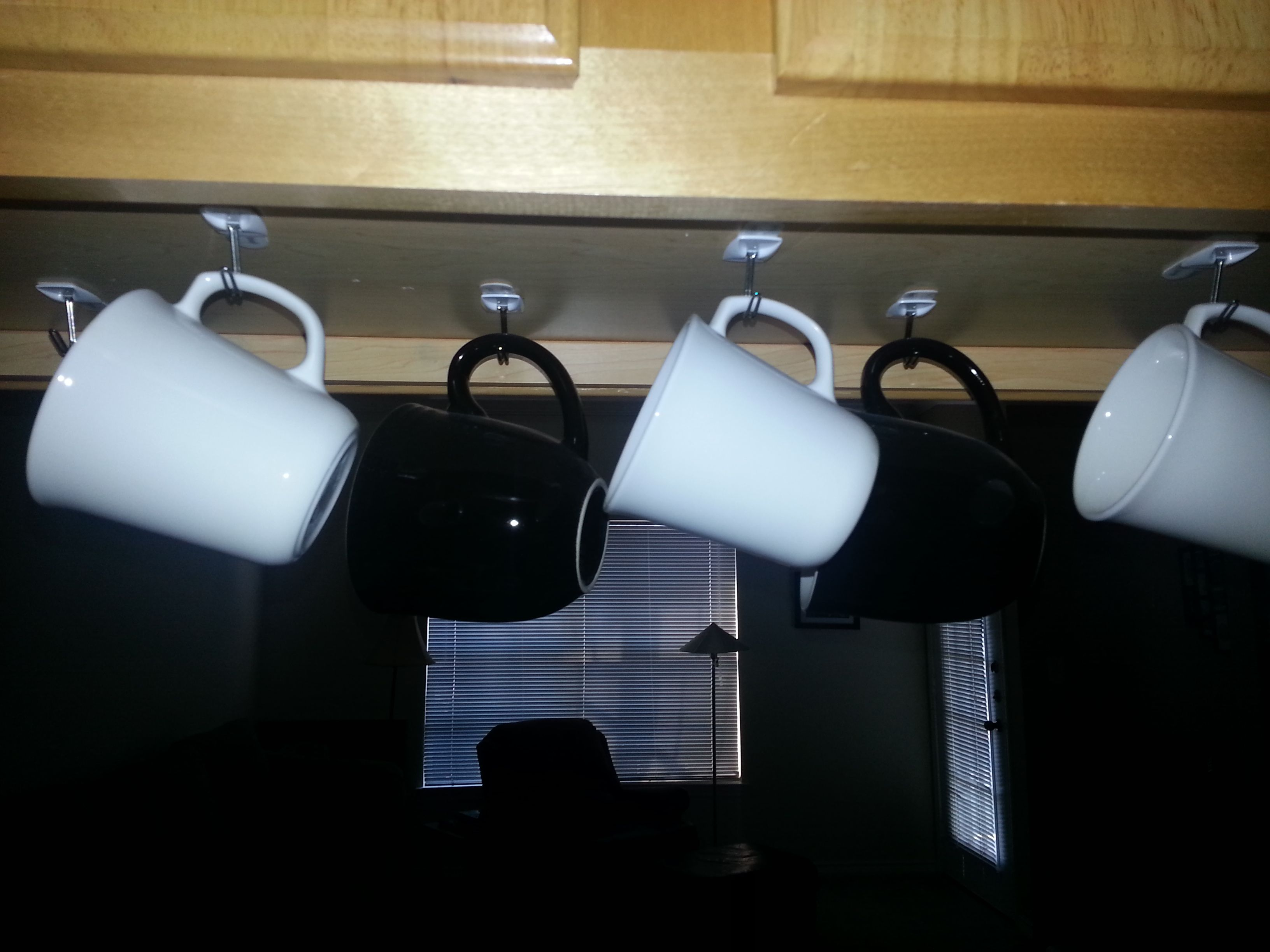I used command strips and hooks to hang my mugs from the top