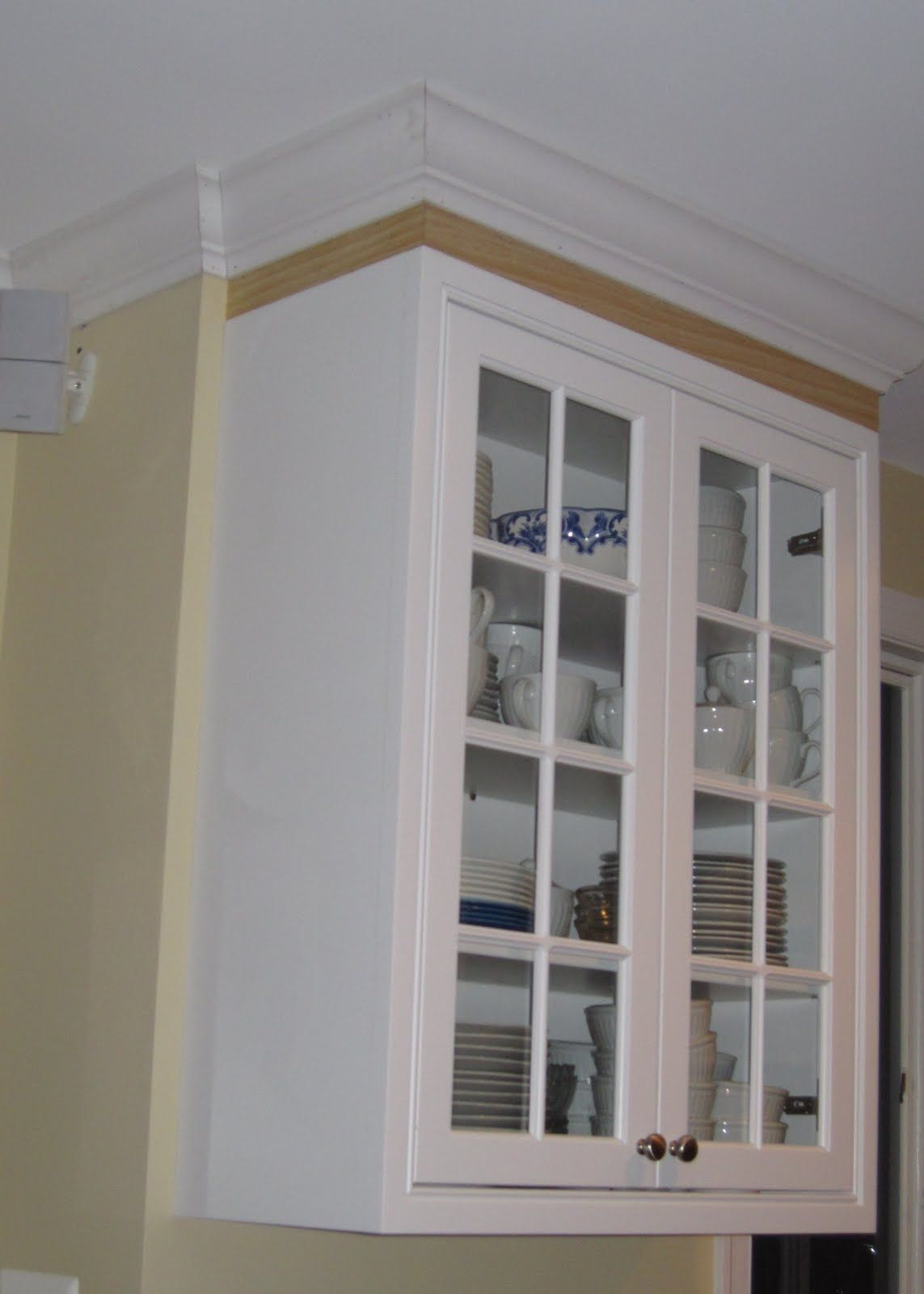 Adding crown molding to top of kitchen cabinets