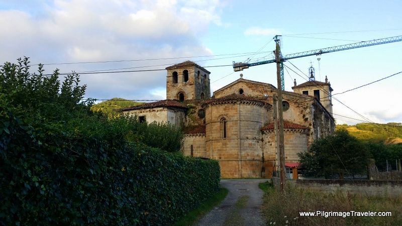 Approaching the monastery of San Salvador de Cornellana in Asturias, Spain, on the Camino Primitivo. This wonderful 12 Century building is being renovated and is still open as an albergue for pilgrims.