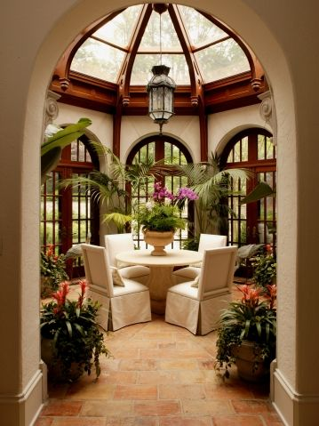 Octagonal sunroom with hand carved trusses and finials for Sunroom dining room ideas