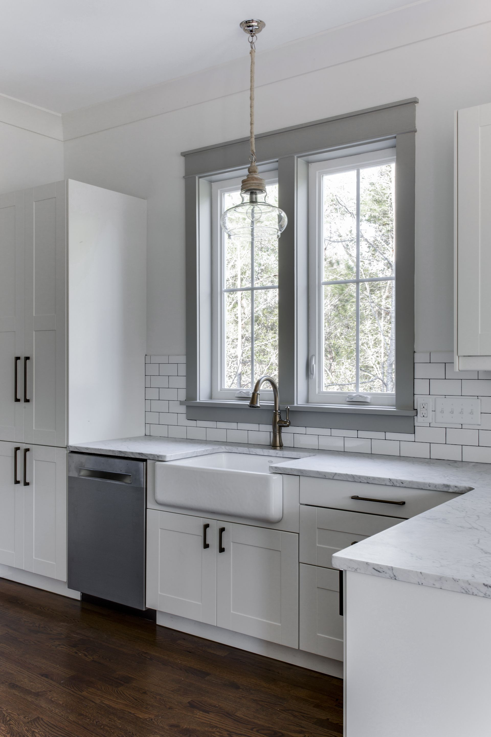 Love the white cabinets farmhouse sink and gray painted