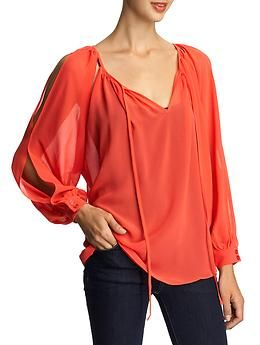 I love these almost peekabo blouses.  Demure enough for the office, sassy enough for life.  Woohooo