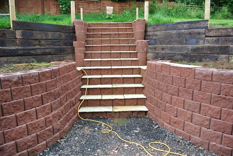 Steps And Retaining Wall Built With Terraforce Red Garden Wall Interlocking Plantable Block Garden Retaining Wall Concrete Retaining Walls Retaining Wall Steps