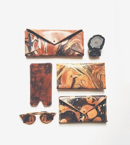 Get an admirable grip on your accessories game. Streamline and upgrade to this leather clutch wallet that mixes business with pleasure.