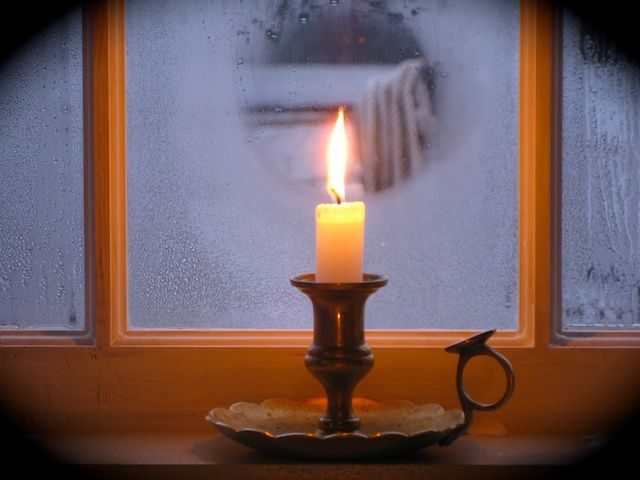 Winter Solstice Candle In The Window Looking Through