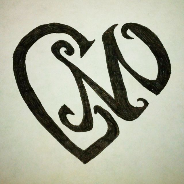 "A heart, made out of the letters ""L"" and ""M""... Took me a ..."