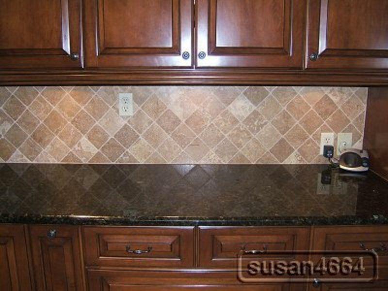 Small Kitchen Design Using Black Granite Counter Tops Including Diagonal Cream Stone Tile Backsplash Dark Cabinet And Solid Cherry Wood