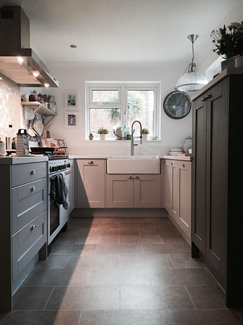 Grey shaker style kitchen with Corian worktops and Belfast sink ...