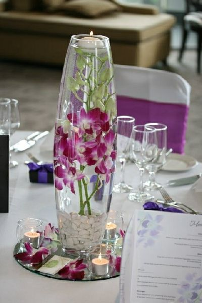 Orchid in bullet vase wedding centrepiece pinterest