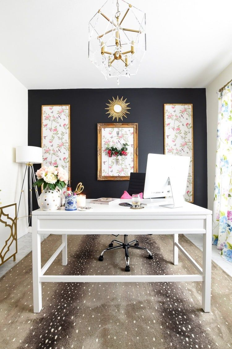 Antelope print rug in a home office with floral curtains, black accent wall, gold decor accents and a large white craft desk. #interiordesignideas #interiorstyling #interiordecorating #interiordesignideas #interiordesigners #interiordesigninspiration #interiordesigning #officedecor #decor #homeoffice #homeofficeideas #DIY #DIYHomeDecor #DIYDecor #decoratingideas