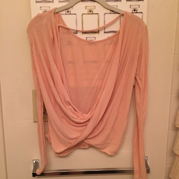 Ever After Twist-Back Top by FP in peach Peach, long sleeved FP tee. Open back detail = perfect for warmer weather & showing off strappy back bras & bralets. Size XS. Only worn a handful of times. No trades. Bundle for an extra 10% off ! Free People Tops Tees - Long Sleeve