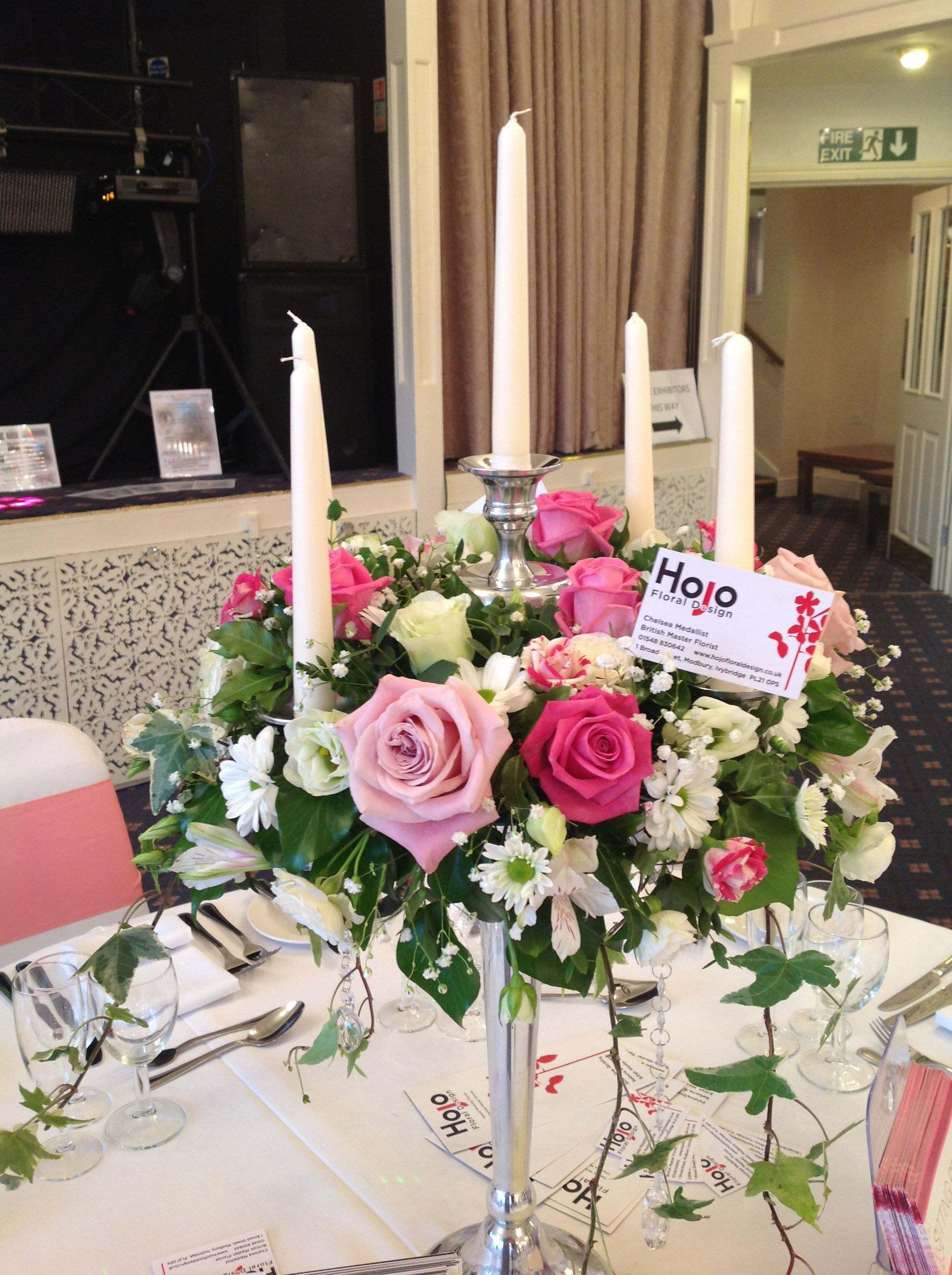 Vintage pink rose candelabra with ivy wedding flowers