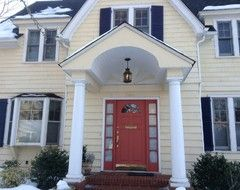 Butter Yellow House White Trim Navy Shutters And Terra Cotta
