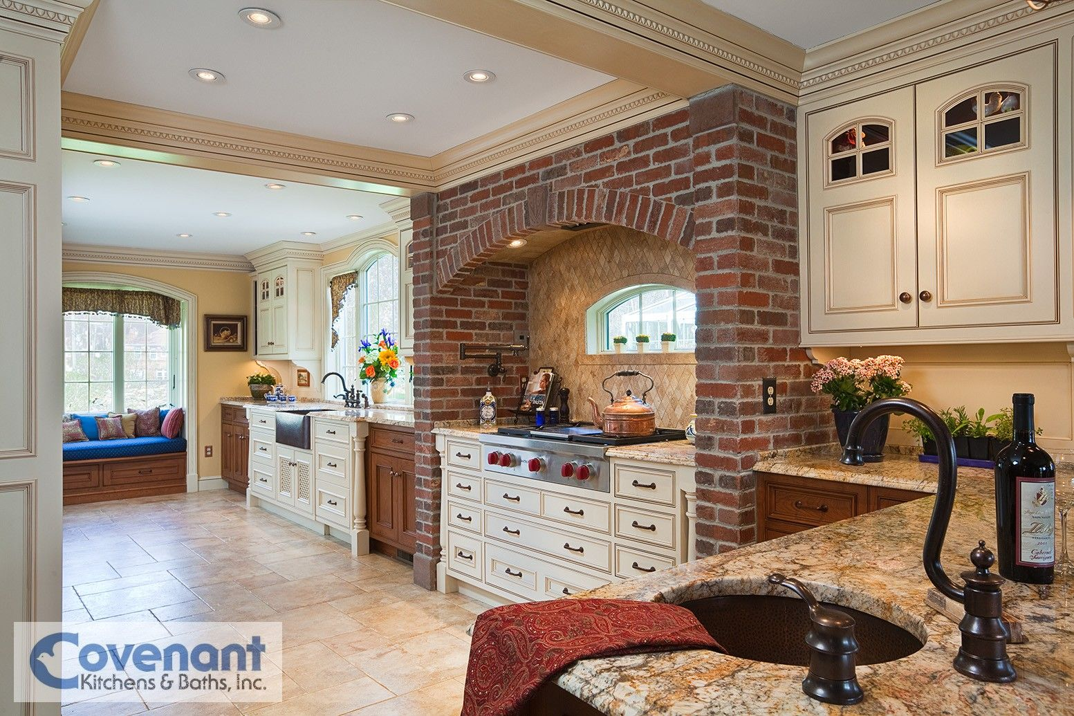 A brick arch over a range top is the centerpiece of this for Kitchen units made of bricks