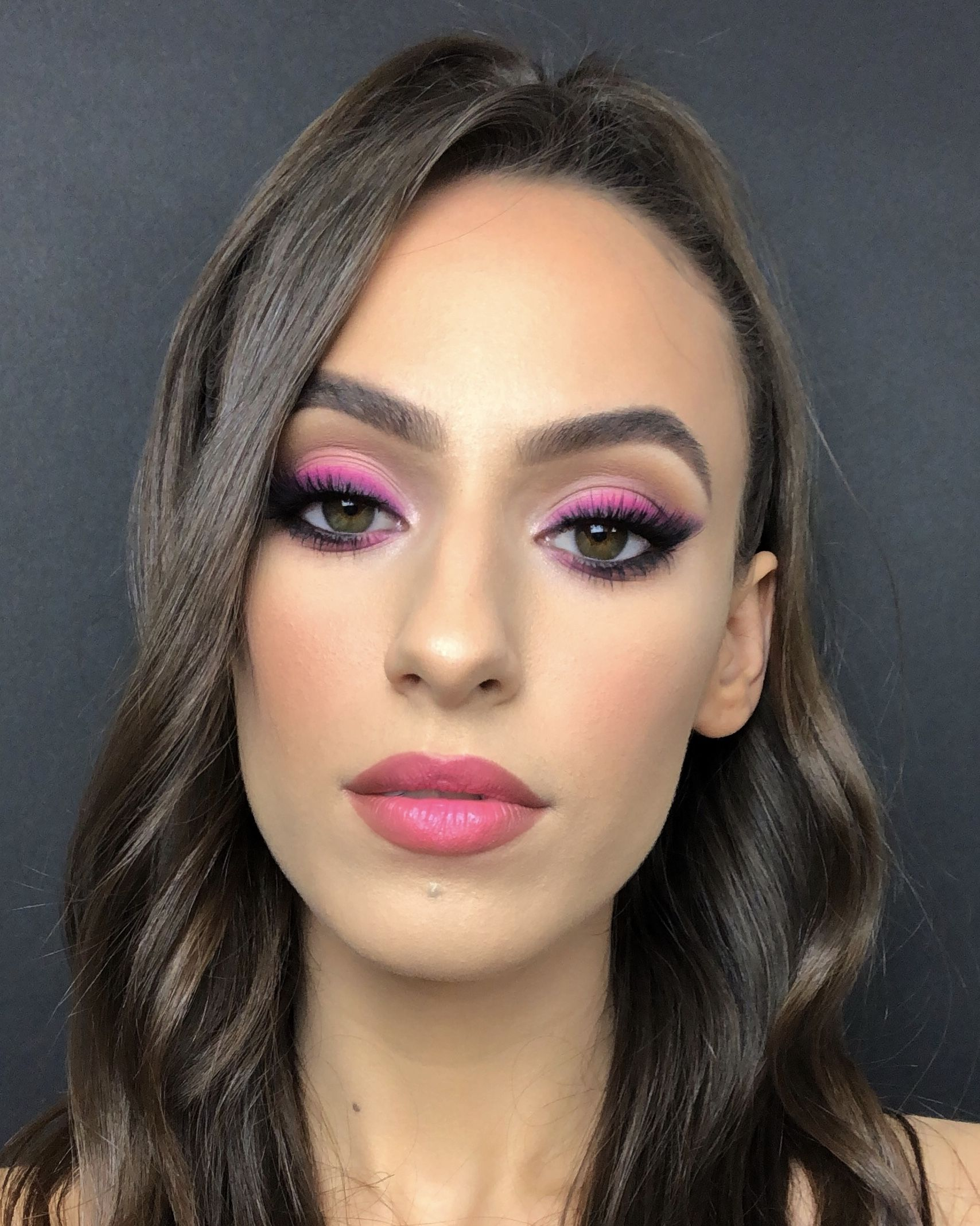 Smokey wing with a pop of bright hot pink. James Charles x