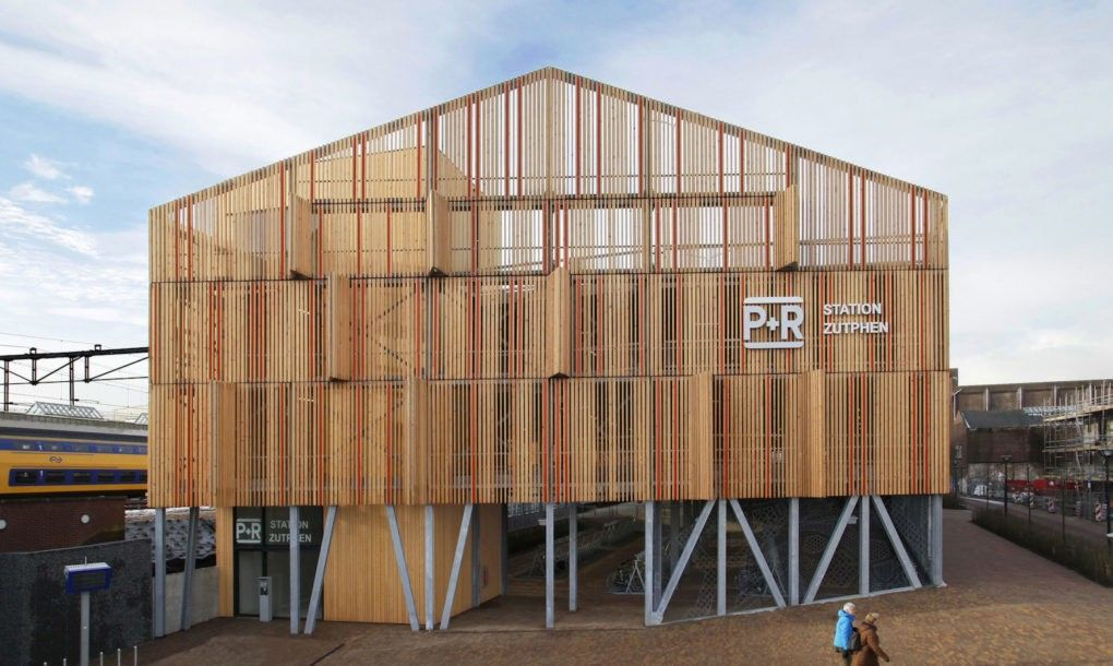 One side of the building features a large gabled facade with wooden shutters to mimic the appearance of a factory warehouse.