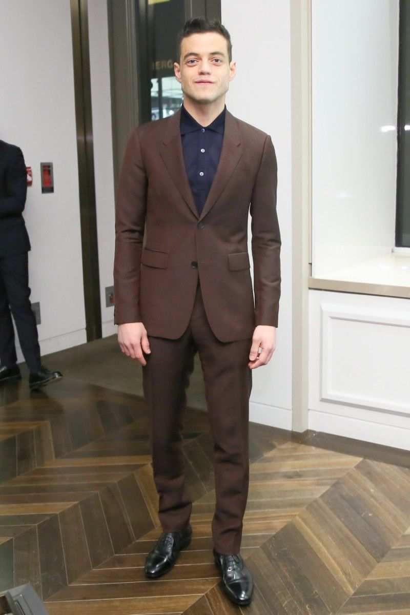 Rami Malek pictured in a Burberry suit at a launch event for Mr. Burberry.