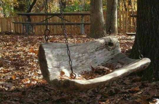 Outdoor swing from old log