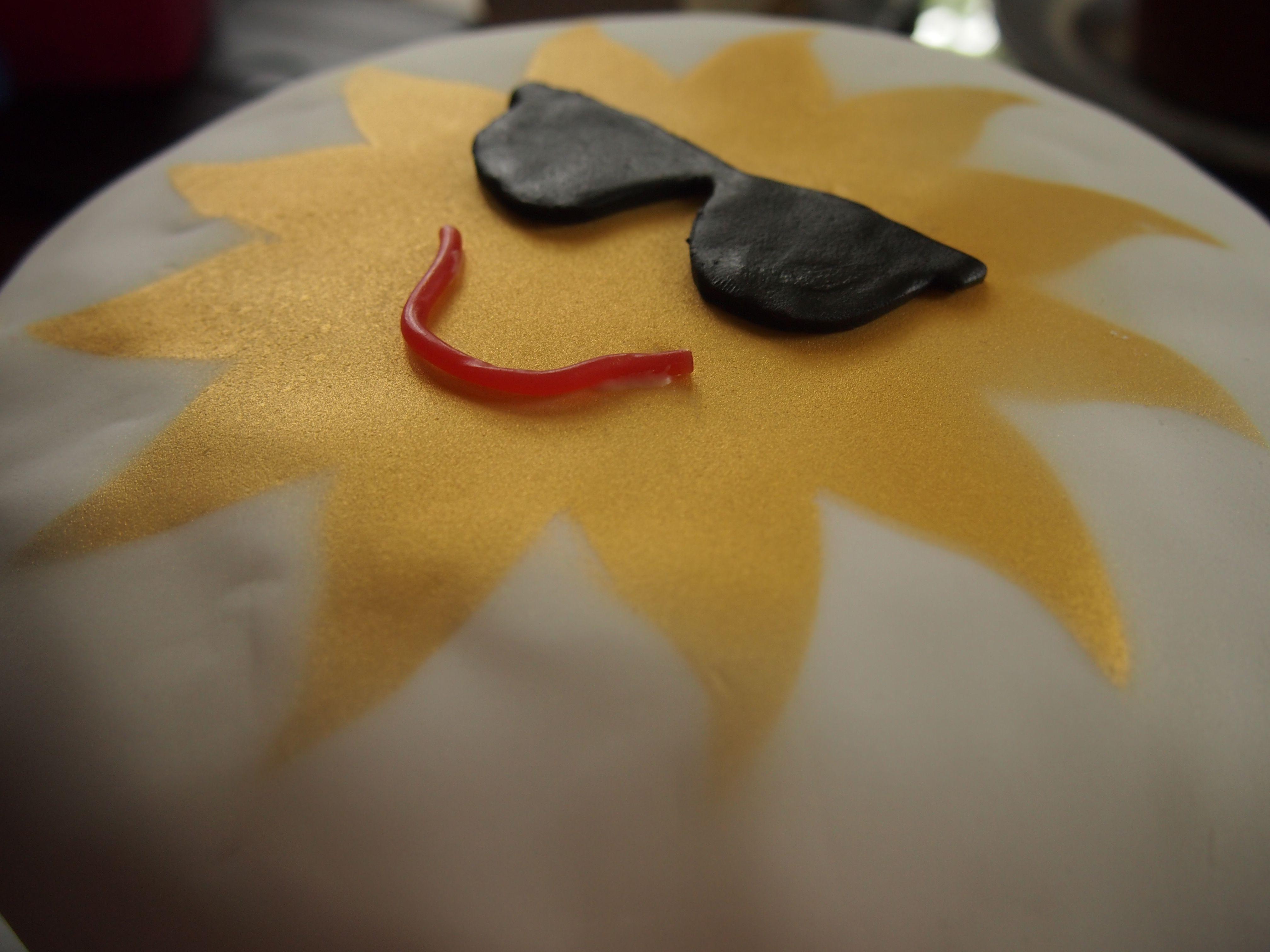 Es 5th birthday cake Sun and rainbow cake Fondant icing with