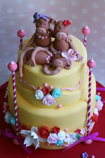Monkey Cake by kylie lambert (Le Cupcake), via Flickr  (I like the colors and the flowers on this one)