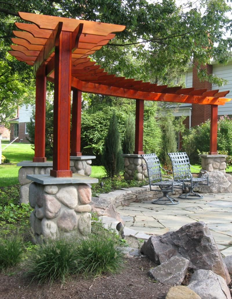 Different shaped pergola makes a nice backdrop for the for Patio ideas and pictures
