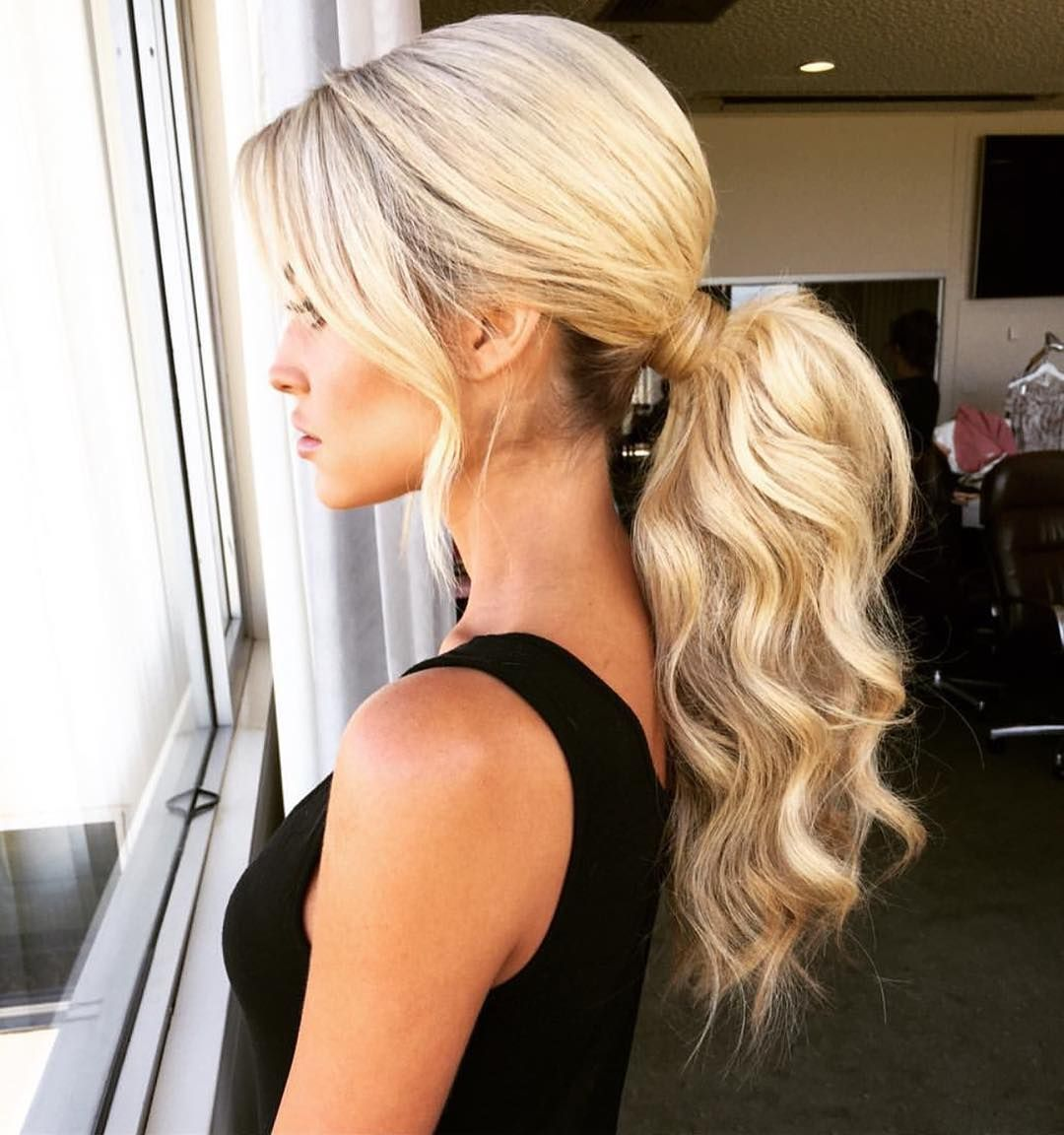 Low Wavy Voluminous Ponytail With Loose Front Strands Ponytail Hairstyles Hair Color For Black Hair Medium Hair Styles