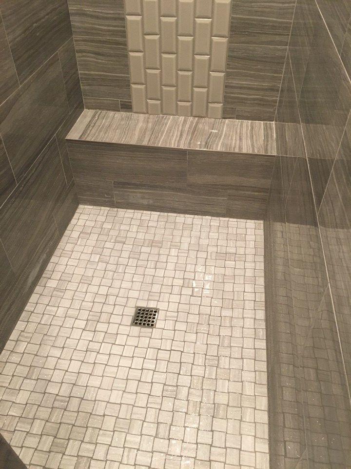Corner Open Walk In Shower Featuring 2 X2 Basket Weave Pattern On The Shower Floor 12 X24 Rectangle Tile On The Show Shower Floor Shower Tile Walk In Shower