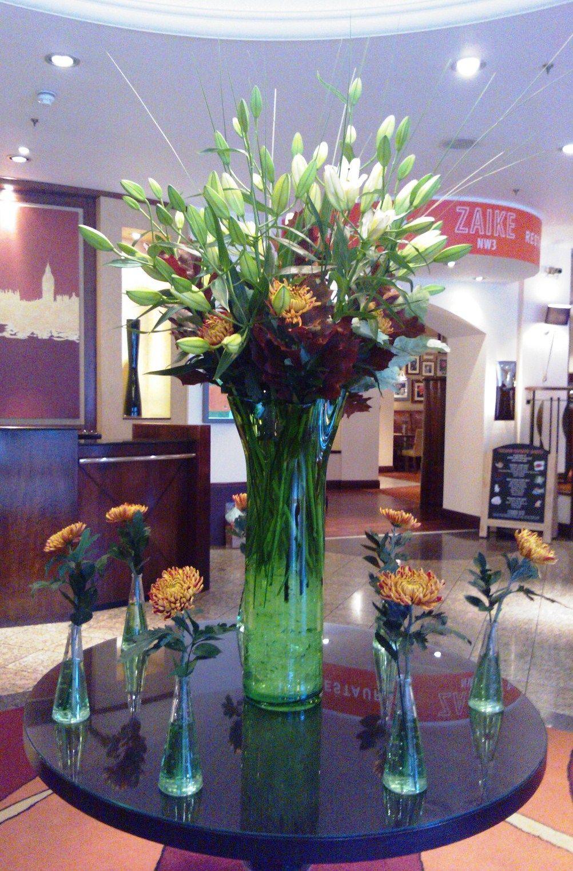 Hotel Foyer Flowers : Creative flower arrangement in the lobby of london