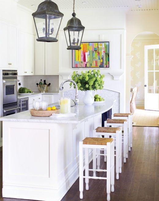 white kitchen, rustic lanterns, pop of artwork