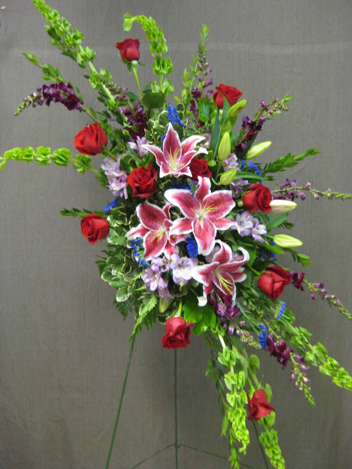 Standing funeral spray. funeralflowers stargazers