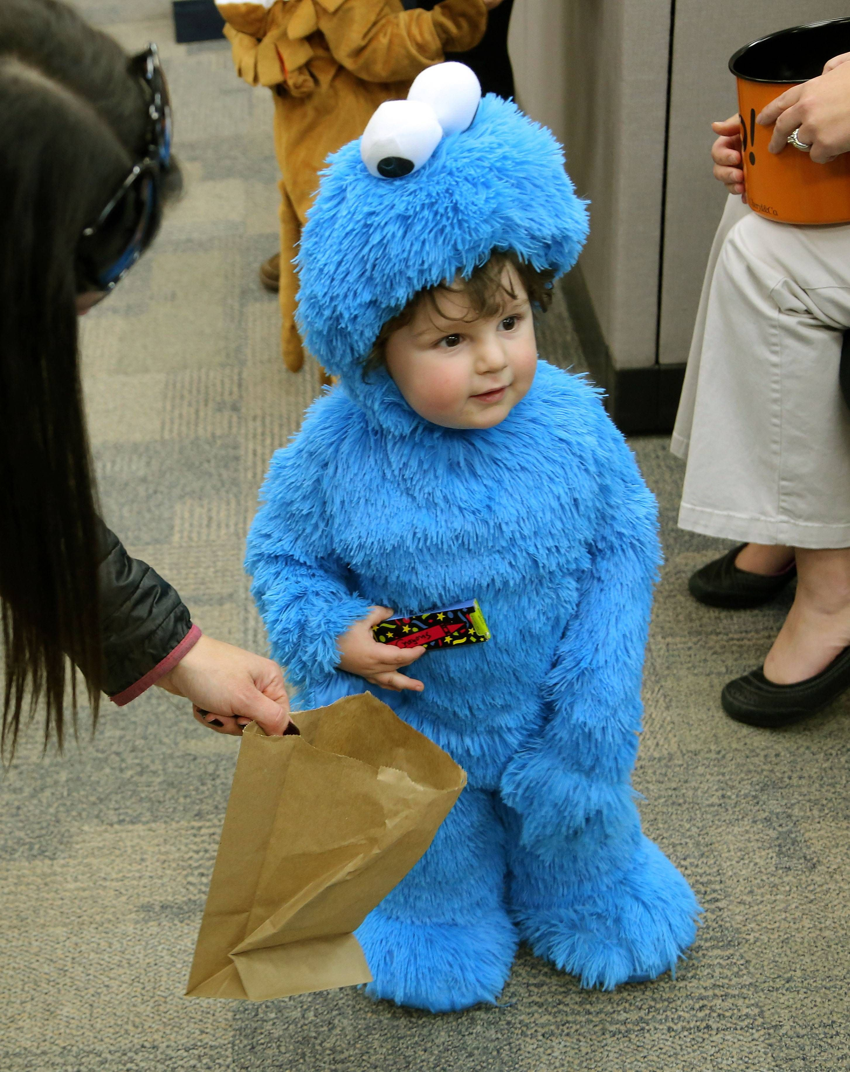 children show off halloween costumes during grayslake library parade