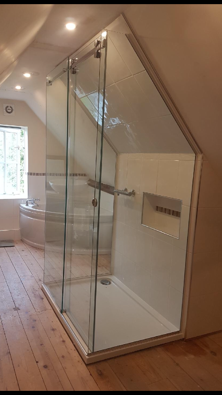 Frameless 3 sided sliding shower enclosure - installed to loft conversion with sloping ceiling. #loftconversions