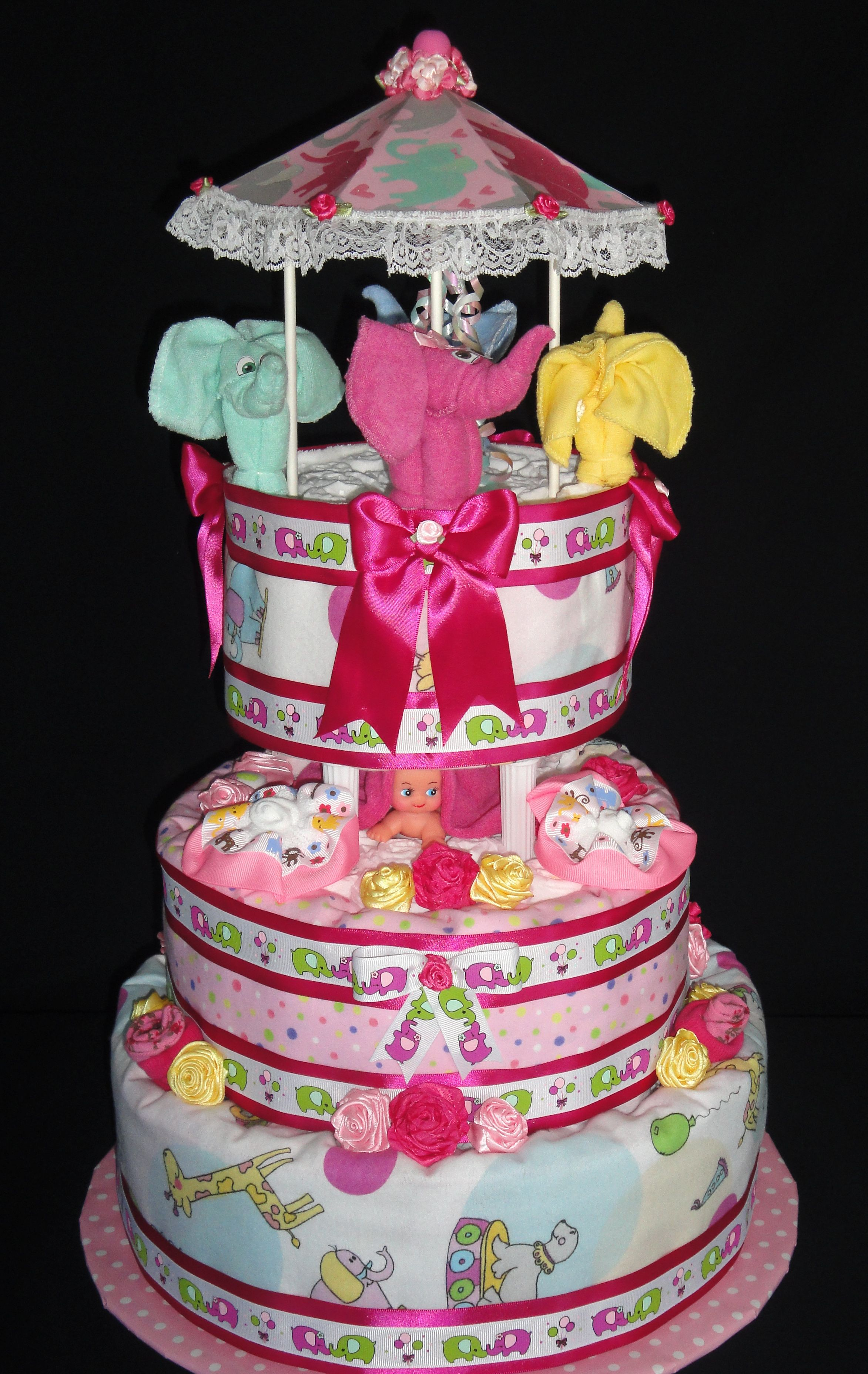 Elephant Carousel Diaper Cake with 120 Pampers Swaddlers created