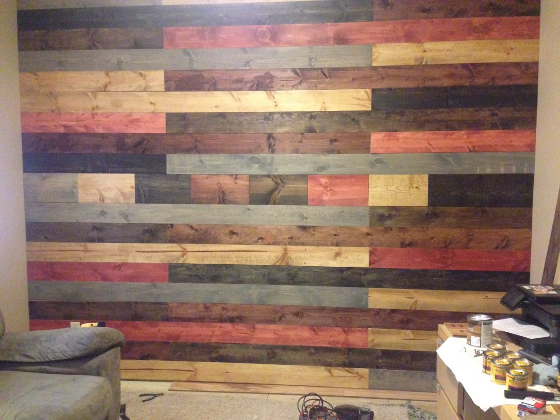 This Weekend Project Turned Into A Statement Wall In Our Den Stained The Boards With Selected Stain Col Pallet Wall Decor Repurposed Decor Homemade Furniture