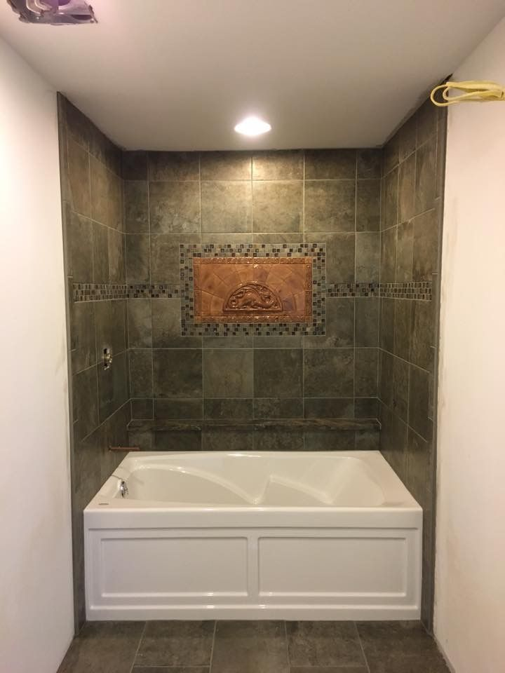 My master bathroom tile Celtic dragon mosaic provided by Earth Song