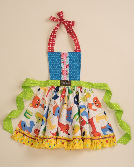 Scraps Under The Table Child Apron  $34.00  Item #: P15NAC28     Select a Size     OS     ADD TO CART   Born with love in the USA. **Apron fabric may vary slightly**